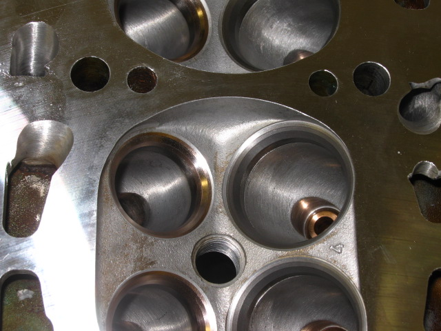 JA 16v_head post insert machining and reface - raw - closeup showing top cut just inside gasket fire-ring.JPG